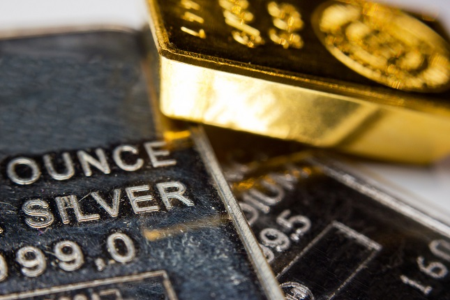 Gold Recovers But Gains Limited By Strong Dollar