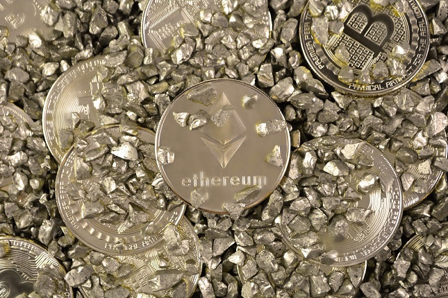 Crypto currency Ethereum and Bitcoin in mound of gold.